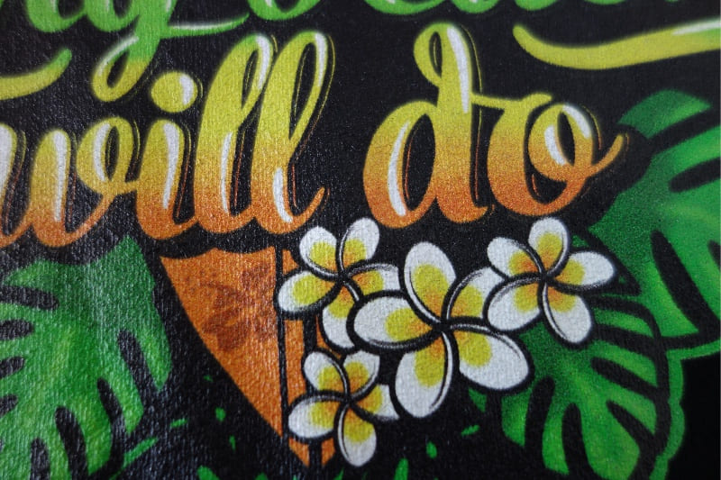 Section of a print on a black t-shirt.