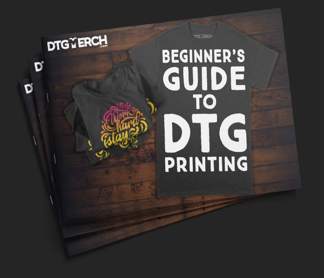 Three books on top of each other. The cover reads: DTG Merch - The Beginners Guide to DTG Printing.