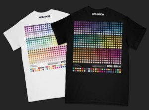 One white t-shirt and one black t-shirt with colored patches printed on.